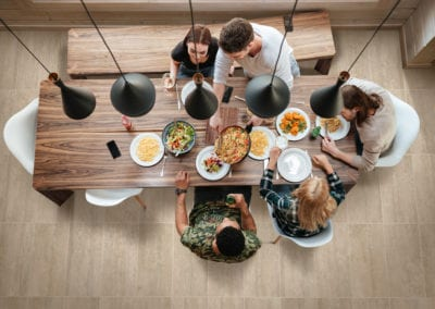Top view of people having dinner together while sitting